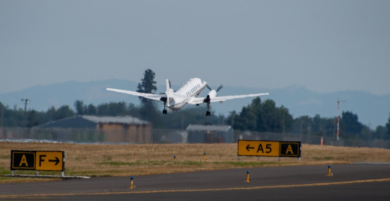 A U.S. Air Force RC-26B Metroliner aircraft assigned to the 162nd Fighter Wing, Arizona Air National Guard, departs on a wildland fire mapping and detection mission in support of the U.S. Forest Service at the Eugene Airport, Eugene, Ore., August 1, 2021.