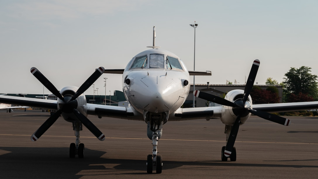 A U.S. Air Force RC-26B Metroliner aircraft assigned to the 162nd Fighter Wing, Arizona Air National Guard, sits on the flight line prior to departing on a wildland fire mapping and detection mission in support of the U.S. Forest Service at the Eugene Airport, Eugene, Ore., August 1, 2021.