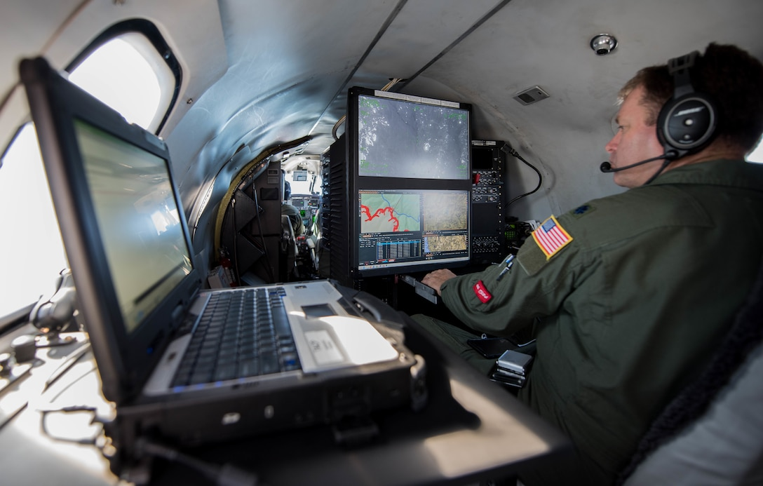 U.S. Air Force Lt. Col. Andy Rathbum, a RC-26 mission system operator assigned to the141st Operations Group, Washington Air National Guard, maps the Chetco Bar fire in southern Oregon using the RC-26s camera Sept. 2, 2017, Brookings, Oregon.
