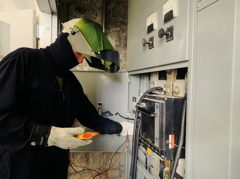 Staff Sgt. Robert Moore, working in electrical protective gear, tests electric power provided by generators from the 118th Civil Engineer Squadron as it powers the Army National Guard Armory in Chattanooga.