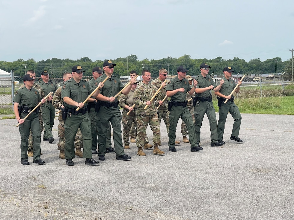 Members from the 118th Security Forces Squadron, Tennessee Air National Guard, train with officers from the Tennessee Highway Patrol on crowd and riot control formations Aug. 7, 2021 at Volunteer Training Site, Smyrna, Tennessee. The exercise is part of the state-wide Vigilant Guard 21 exercise, which helps keeps members prepared and ready in case a major disaster were to affect Tennessee. (U.S. Air National Guard courtesy photo by Tech. Sgt. Daron Dixon)