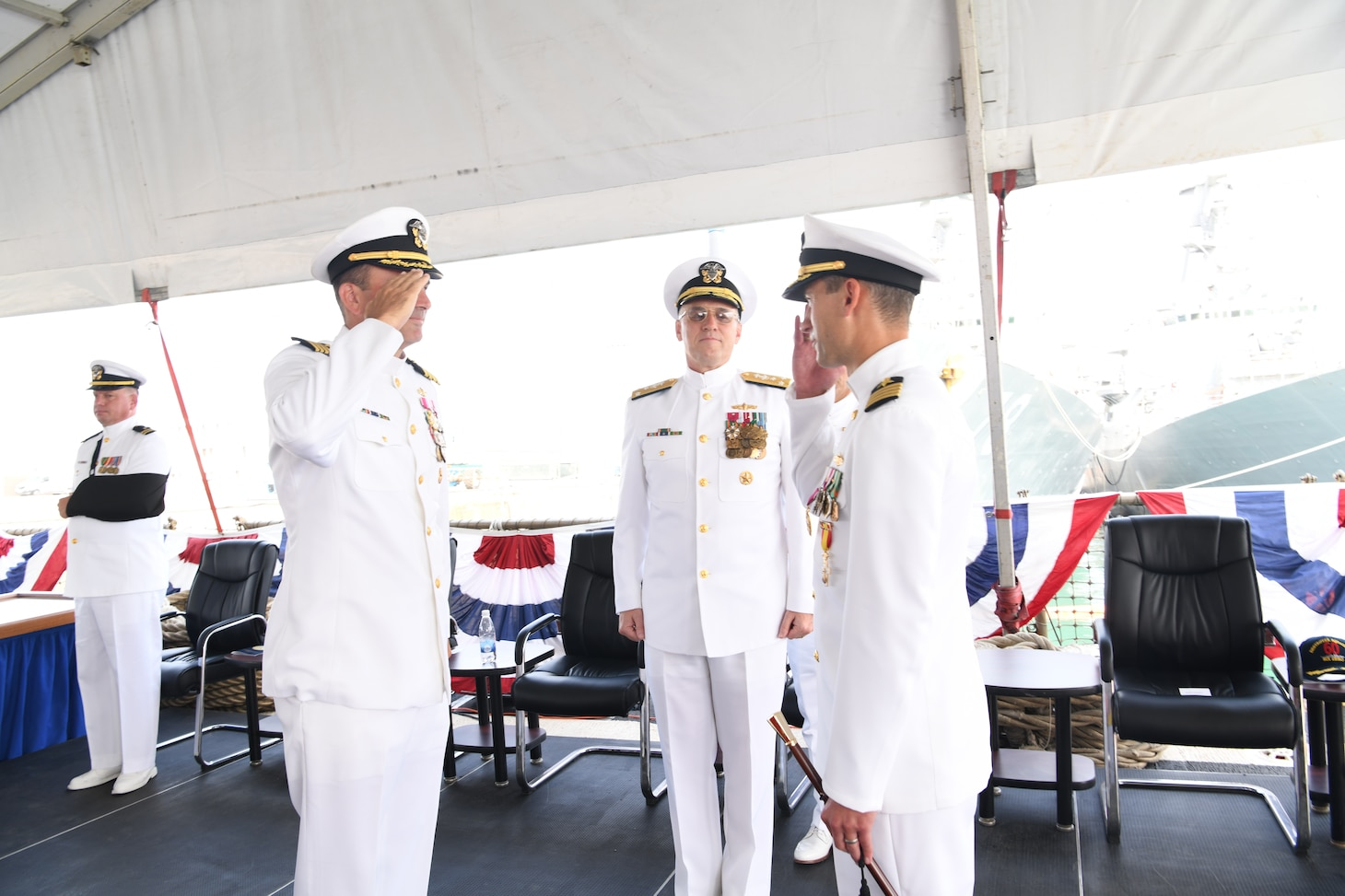 Capt. Kyle Gantt, left, assumes command as commodore, Commander, Task Force (CTF) 65 from Capt. Joseph Gagliano, right, while presided over by Vice Adm. Gene Black, commander, U.S. Sixth Fleet, center, during a change of command ceremony at Naval Station Rota, Aug.10, 2019. CTF 65 and DESRON 60, headquartered in Rota, Spain, overseas the forward-deployed forces of U.S. Sixth Fleet's area of operation in support of regional allies and partners as well as U.S. national security interests in Europe and Africa.