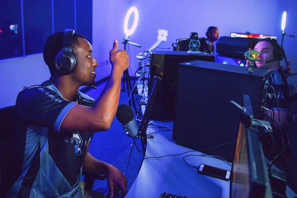 Tech. Sgt. Maurice Moyer, team captain for the Department of the Air Force Gaming Space Force team, gives a thumbs up to one of his teammates during a DAFG Season 1 tournament. Air Force launched the gaming league in 2020 to foster resiliency and retention through global e-sports events that bring Airmen and Guardians together in competitive leagues.