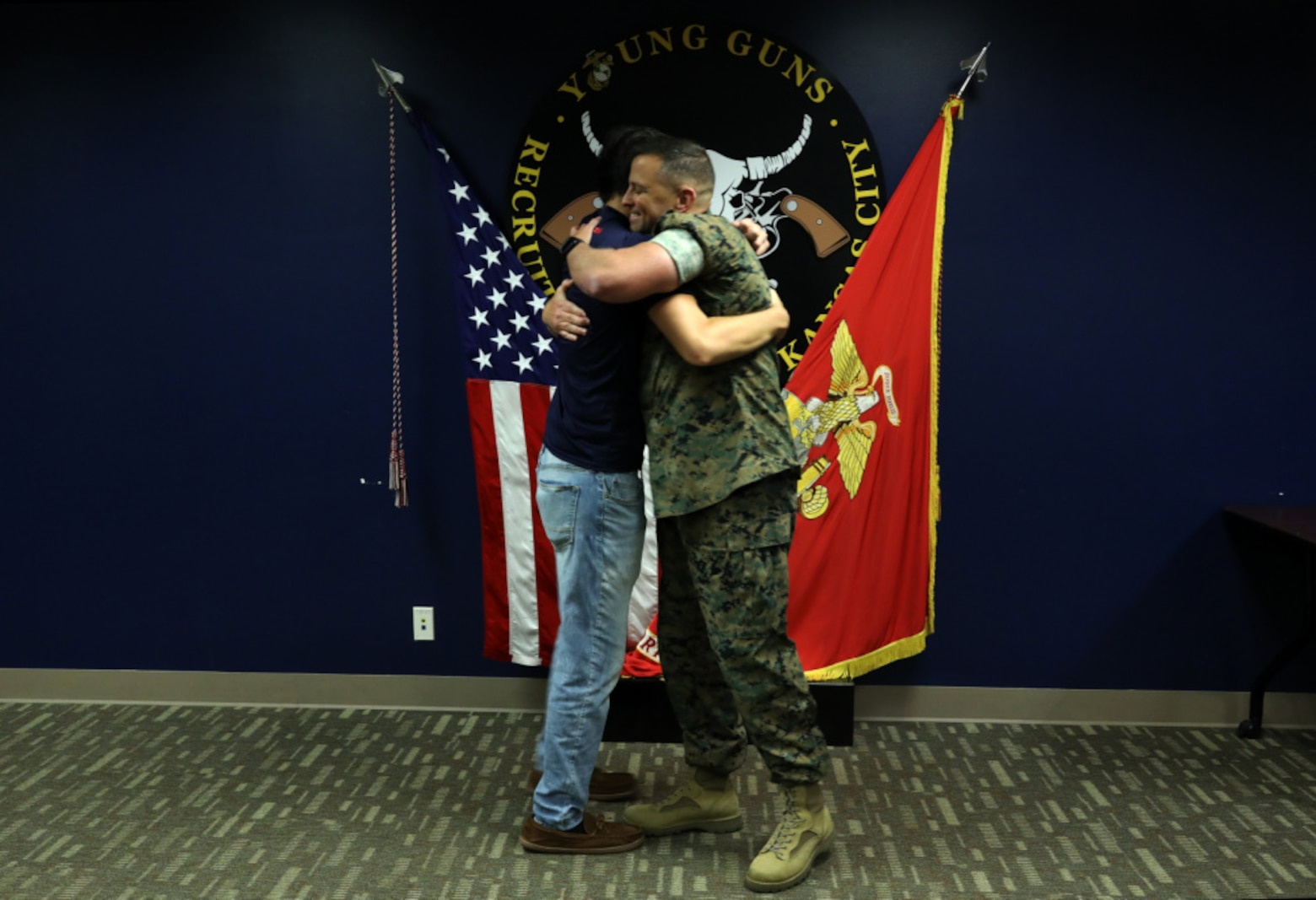 Daniel Hayek (left) and his father Maj. Richard Hayek, the Commanding officer of Marine Corps Recruiting Station Kansas City, embrace after Daniel took the Oath of Enlistment from his father at Kansas City Military Entrance Processing Station in Kansas City, Mo., July 26, 2021. By committing to the Marines, Daniel is poised to become a fourth-generation service member in his family-- following the footsteps of his mother, father, grandfather and great-grandfather. Daniel graduated from Navarre High School in Navarre, Fla., in 2020.