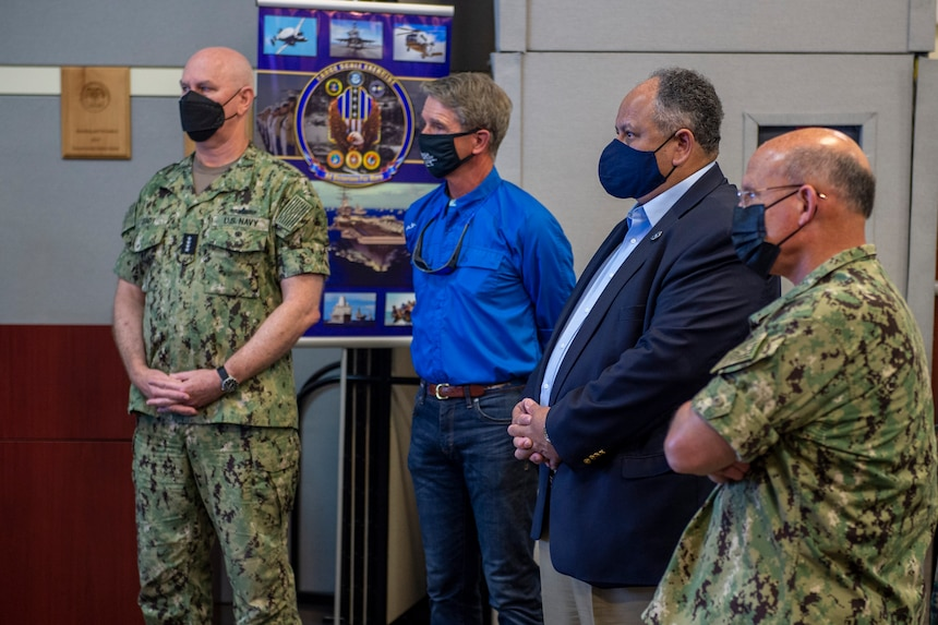 Capt. Christopher Narducci, director, Fleet Training Interoperability, left, briefs Secretary of the Navy Carlos Del Toro, center right, Chief of Naval Operations Adm. Mike Gilday, right, Adm. Christopher W. Grady, commander, U.S. Fleet Forces Command, and Virginia Representative Rob Wittman at the Naval Warfare Development Command during Large Scale Exercise (LSE) 2021 in Norfolk, Va., August 10, 2021.