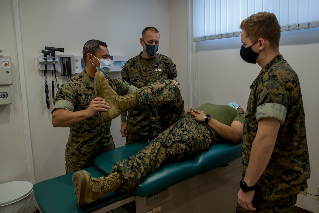 OKINAWA, Japan (Aug. 6, 2021) U.S. Navy Hospital Corpsman 1st Class Peter Daniel, middle, an independent duty corpsman with 3rd Marine Logistics Group (MLG), teaches basic provider skills to corpsmen during a Corpsman Critical Exchange Program (CCEP) on Camp Hansen, Japan.