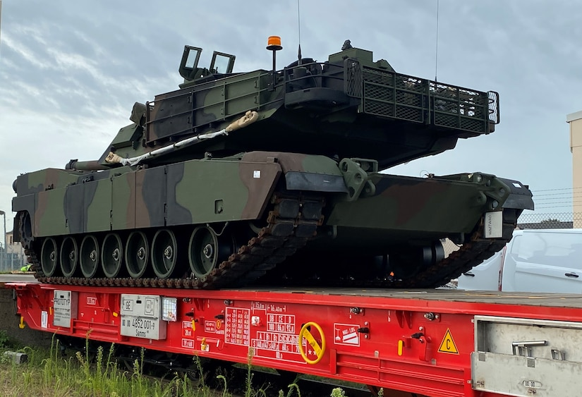 An M1A2 SEPv3 Abrams tank from Army Field Support Battalion-Mannheim's Army Prepositioned Stock site at Coleman Worksite is driven onto a newly redesigned prototype rail car Aug. 10. The SEPv3 Abrams is heavier than its predecessors, weighing more than 73 tons.