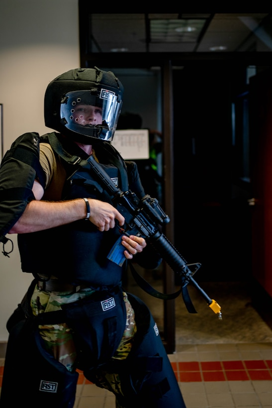 Senior Airman Riley Tarrell, 114th Security Forces fire team member, acts as the shooter during an active shooter training as part of the 2021 Readiness Exercise Aug. 10, 2021, at Joe Foss Field, S.D.