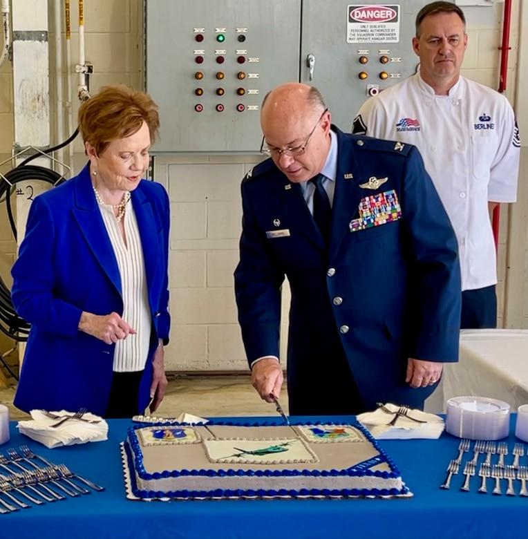 Col Williams cuts a cake with Congresswoman Granger.