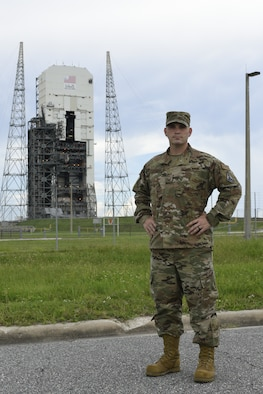 Master Sgt. Keith Carpenter, Space Launch Delta 45 Inspector General superintendent, stands in front of a space launch complex Aug. 9, 2021, at Cape Canaveral Space Force Station, Florida. Carpenter, who in 2020 was a 5th Space Launch Squadron spacecraft flight chief, won the Space Operations Command Space Launch Maintainer of the Year award in the senior noncommissioned officer category. (U.S. Space Force photo by Airman 1st Class Samuel Becker)