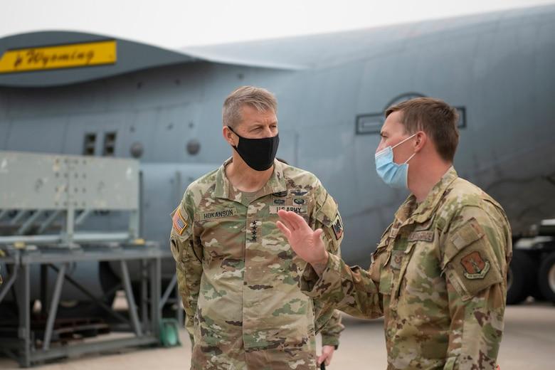 U.S. Air Force Technical Sgt. Timothy Williams explains the Modular Airborne Fire Fighting System (MAFFS) to Army Gen. Daniel Hokanson, chief, National Guard Bureau, at the Wyoming Air National Guard base, Cheyenne, Wyo., Aug. 7, 2021.