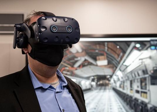 Photo of Dr. Albert Lowas using a virtual reality training aid.