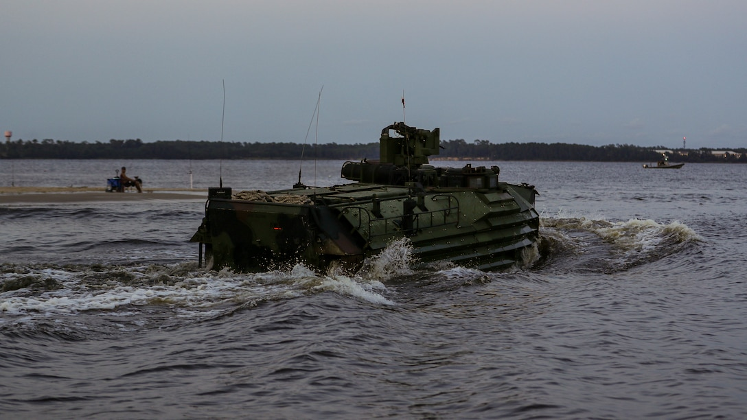 An AAV7A1 assault amphibious vehicle conducts a wet-gap amphibious crossing as part of a company-sized infiltration on Camp Lejeune, N.C., Aug. 10, 2021.