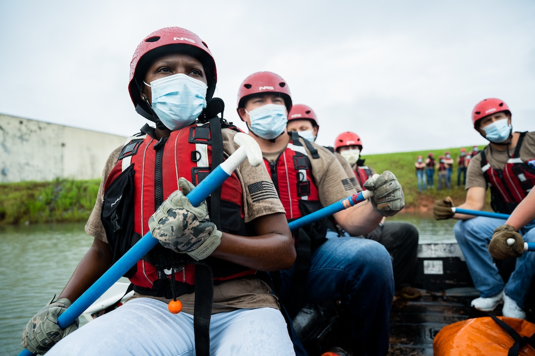 Airmen paddle in a raft