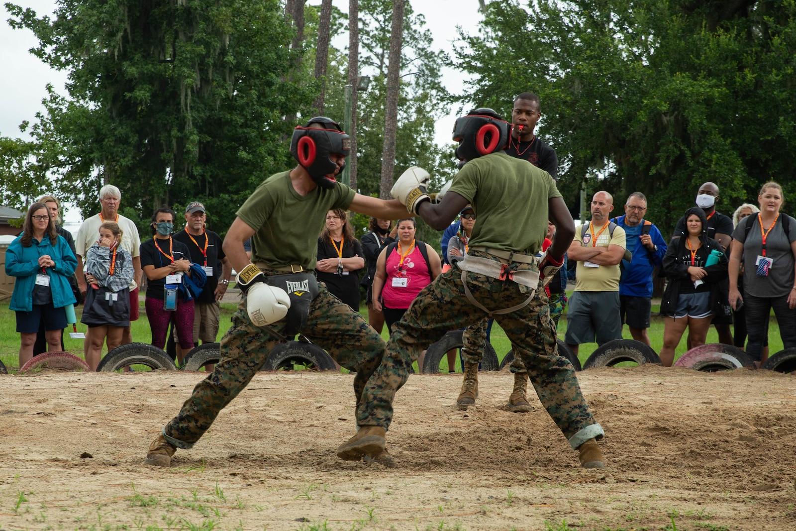 Educators observe recruits conduct martial arts training at Marine Corps Recruit Depot Parris Island, Sc., August 5, 2021.
