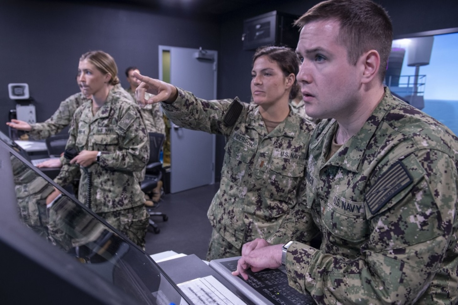 210727-N-OA516-1050 SAN DIEGO (July 27,2021) – Students attending the officer of the deck training course at the Mariner Skills Training Center, Pacific (MSTCPAC), take part in a simulated ship handling exercise. MSTCPAC, established in October 2020, conducts hands-on seamanship and navigation training as part of the revamped Surface Warfare Officer Training Pipeline. (U.S. Navy photo by Mass Communication Specialist 2nd Class Kevin C. Leitner)