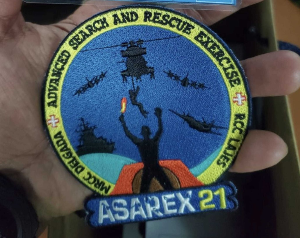 An Airman displays the patch awarded to those participating in ASAREX 2021, a NATO search and rescue exercise hosted by the Portuguese Air Force in the Azores at the end of July 2021. The New York Air National Guard's 106th Rescue Wing  participated in the training.