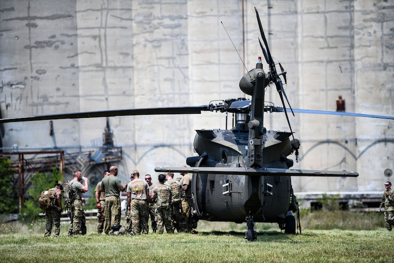 Approximately 120 members of the 445th Aeromedical Staging Squadron, 944th ASTS, Luke AFB, Arizona, and the 244th Aviation Combat Brigade, Fort Knox, Kentucky, undergo Tactical Combat Casualty Care training at Wright State University's Calamityville, Fairborn, Ohio, August 7, 2021. Calamityville is a training, testing, and research venue where military and civilian emergency first responders hone their skills while building relationships. The training was designed to increase skills in caring for combat wounded in challenging remote locations where traditional medical evacuation may not be possible.