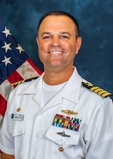 Official portrait of Capt. Brian Tanaka, commanding officer, Naval Submarine Training Center Pacific.