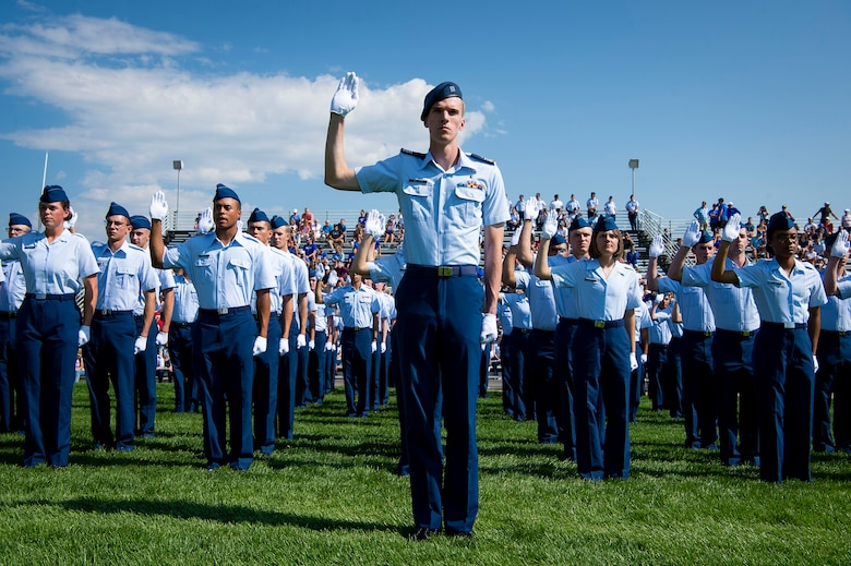 C1C Benjamin Miller, Demons Echo Flight commander, leads a group of fourth class cadets to cite the honor oath during the U.S. Air Force Academy's Acceptance Day ceremony at Stillman Parade Field