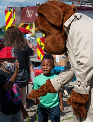 Firefighters and firetrucks at National Night Out