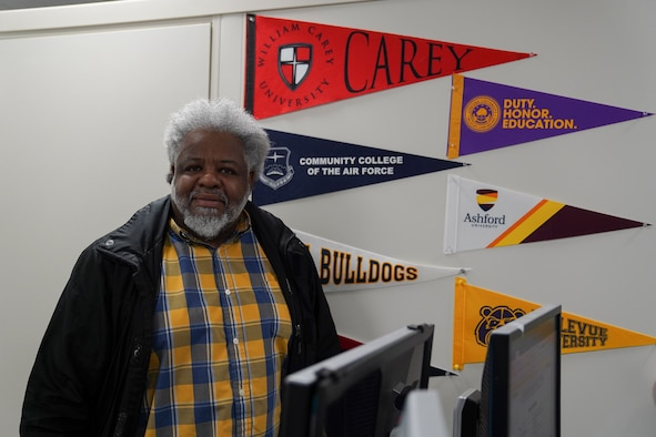 Louis Bridges, 81st Force Support Squadron education service specialist, poses in his office inside the Sablich Center at Keesler Air Force Base, Mississippi, Aug. 9, 2021. Bridges was one of 19 individuals nationwide to win the 2021 Veteran Champion of the Year award.