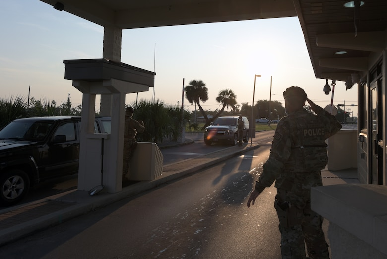 Members of the 325th Security Forces Squadron verify base access credentials