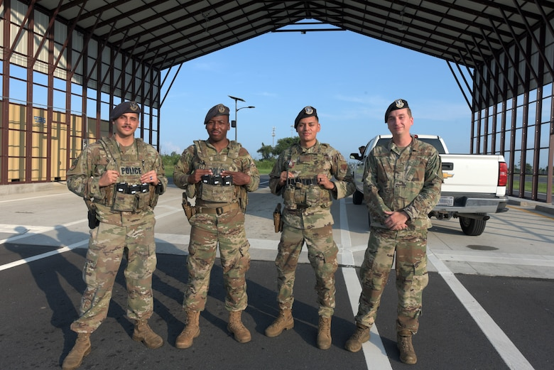 Vehicle search specialists, pose for a photo