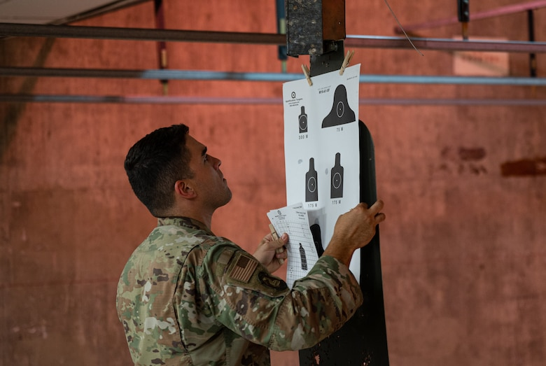 U.S. Air Force Senior Airman Ramon Rosa Aponte, 56th Security Forces Squadron defender, hangs targets during a weapons qualification course Aug. 3, 2021, at Luke Air Force Base, Arizona.