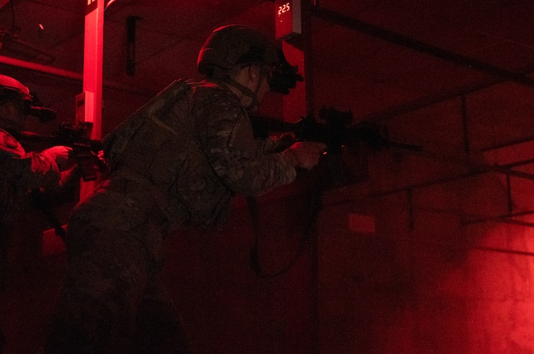 U.S. Air Force Senior Airman Noah Huff, 56th Security Forces Squadron military working dog handler, fires an M41A rifle while using night-vision goggles during a weapons qualification course Aug. 3, 2021, at Luke Air Force Base, Arizona.