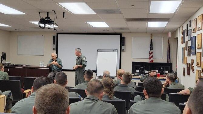 A photo of a civilian briefing Airmen