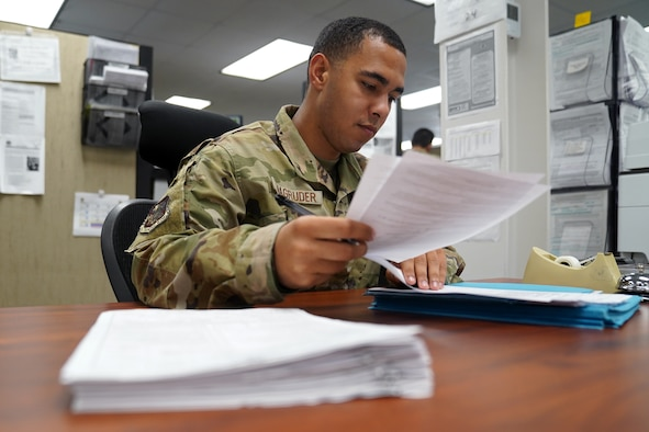 U.S. Air Force Airman 1st Class Noah Magruder, 81st Comptroller Squadron special actions technician, computes travel entitlements inside the Sablich Center at Keesler Air Force Base, Mississippi, July 28, 2021. From managing the finances of Keesler personnel to being a part of the Keesler Airman's Council and creating the Junior Enlisted Professional Enhancement Seminar, Magruder embraces his role as an Airman and acknowledges his impact on the mission. (U.S. Air Force photo by Senior Airman Seth Haddix)