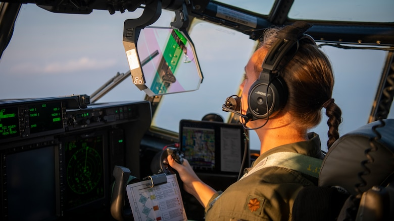 U.S. Air Force Maj. Catherine Olszewski, a 417th Flight Test Squadron pilot, flies a modified EC-130J Commando Solo during Operation Blood Rain near Eglin Range, Florida, Aug. 5, 2021.