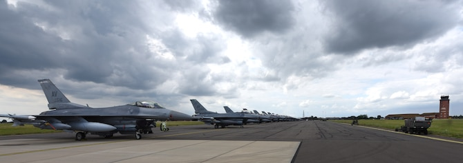 U.S. Air Force F-16 Fighting Falcon aircraft assigned to the 31st Fighter Wing, Aviano Air Base, Italy, sit on the flightline at Royal Air Force Mildenhall, England, Aug. 3, 2021. The F-16 is a compact, multi-role aircraft which is maneuverable and has proven itself in air-to-air combat and air-to-surface attack. (U.S. Air Force photo by Karen Abeyasekere)
