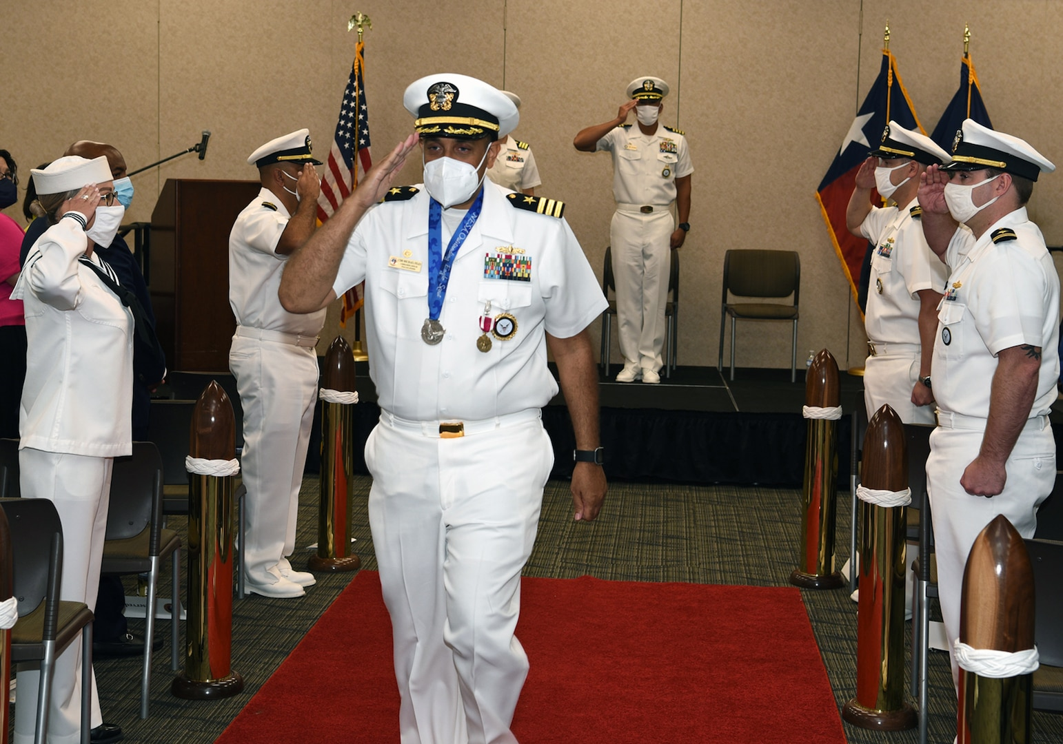 """Cmdr. Michael Files, former commanding officer of Navy Talent Acquisition Group San Antonio, was """"piped ashore"""""""