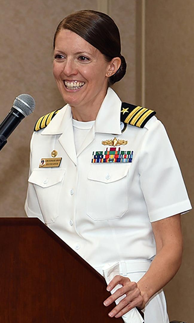 Cmdr. Stephanie Simoni speaks to Sailors