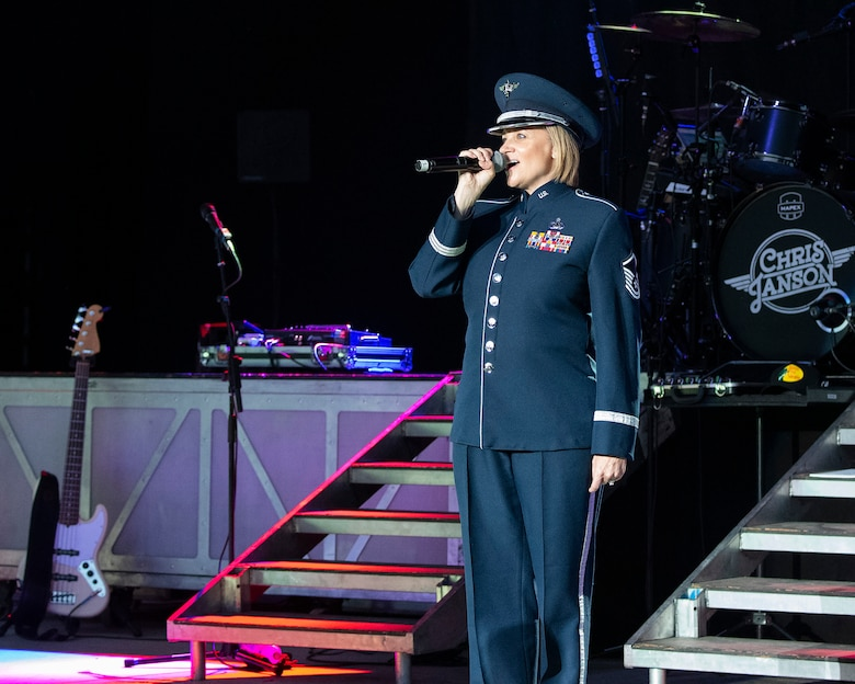 Master Sgt. Christin Foley, U.S. Air Force Band of Flight vocalist, performs the national anthem Aug. 5, 2021, before country star Chris Janson's concert at Fraze Pavilion in Kettering, Ohio. The concert was part of the Dayton Development Coalition's Hometown Heroes program. (U.S. Air Force photo by R.J. Oriez)