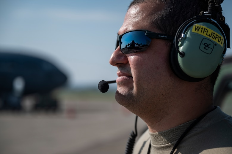 Tech. Sgt. Jorge Padron, 911th Aircraft Maintenance Squadron crew chief, observes and talks to fellow Airmen while inspecting a C-17 Globemaster III engine during Operation Steel Moose '21 at the Pittsburgh International Airport Air Reserve Station, Pennsylvania, Aug. 5, 2021. Airmen assigned to the 911th AMXS prepare aircraft to prove they can provide mission ready aircraft.