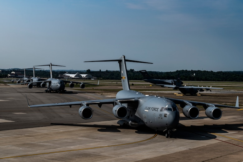 C-17 Globemaster III aircraft assigned to the 911th Airlift Wing line up on the flight line as they prepare to takeoff as part of Operation Steel Moose '21 at the Pittsburgh International Airport Air Reserve Station, Pennsylvania, Aug. 8, 2021. Operation Steel Moose '21 is a readiness exercise testing the capabilities of the 911th Airlift Wing.
