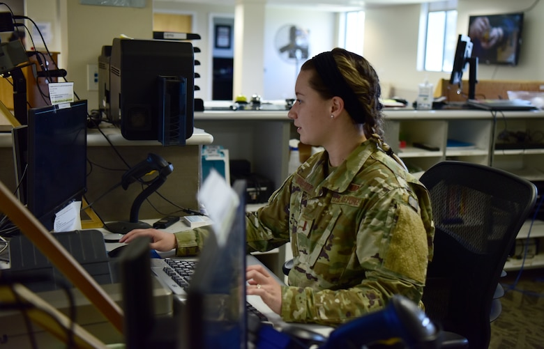 U.S.  Air Force, 2nd Lt. Gabrielle Prentice, Officer in Charge over customer support at the Military Personnel Flight office on Vandenberg Space Force Base, July 28, 2021. 2nd Lt. Prentice is working on some paperwork to help one of her customers that contacted her through email. (U.S. Space Force photo by Airman First Class Tiarra Sibley)