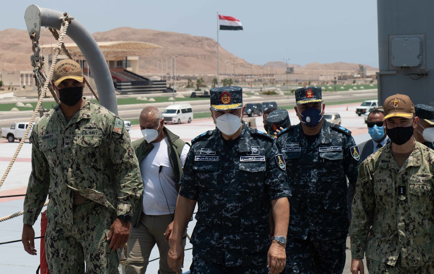 BERENICE, Egypt (August 12, 2021) – Capt. Joseph Baggett, commanding officer of guided-missile cruiser USS Monterey (CG 61), left, Vice Adm. Ahmed Khaled Hassan Saeed, commander of the Egyptian Naval Force, center, and Vice Adm. Brad Cooper, commander of U.S. Naval Forces Central Command (NAVCENT), U.S. 5th Fleet and Combined Maritime Forces (CMF), far right, walk together during a tour of the ship in Berenice, Egypt, Aug. 12. Monterey is deployed to the U.S. 5th Fleet area of operations in support of naval operations to ensure maritime stability and security in the Central Region, connecting the Mediterranean and Pacific through the western Indian Ocean and three strategic choke points. (U.S. Navy photo by Mass Communication Specialist Seaman Chelsea Palmer)