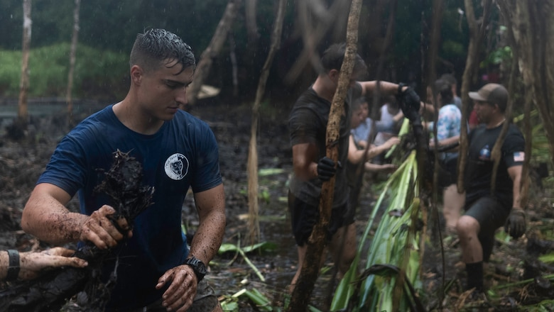 U.S. Marines with Task Force Koa Moana 21, I Marine Expeditionary Force, work hand-in-hand with the local people of Palau to clean Lake Ngardok, the largest natural freshwater lake in all of the islands of Micronesia, during a monthly event where the locals come together to remove the large amounts of growing Cheuais plants in lake Ngardok, Melekeok, Republic of Palau, August 7, 2021. TFKM 21 builds upon the shared interests of the U.S. and Republic of Palau and is committed to improve the abilities of the two countries working together ahead of real-world crises.  * Required