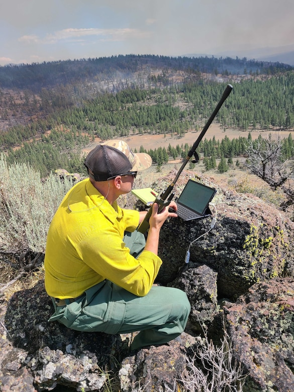 Master Sgt. Brent Hill, Pennsylvania Air National Guard, controls the IR imagery on an RC26 in support of burn operations on the BECKWOURTH FIRE in California from a location in western Nevada July 13.  He is serving as part of a team of imagery experts providing live aerial video streaming to fire bosses working on the front lines of the devastating fires.