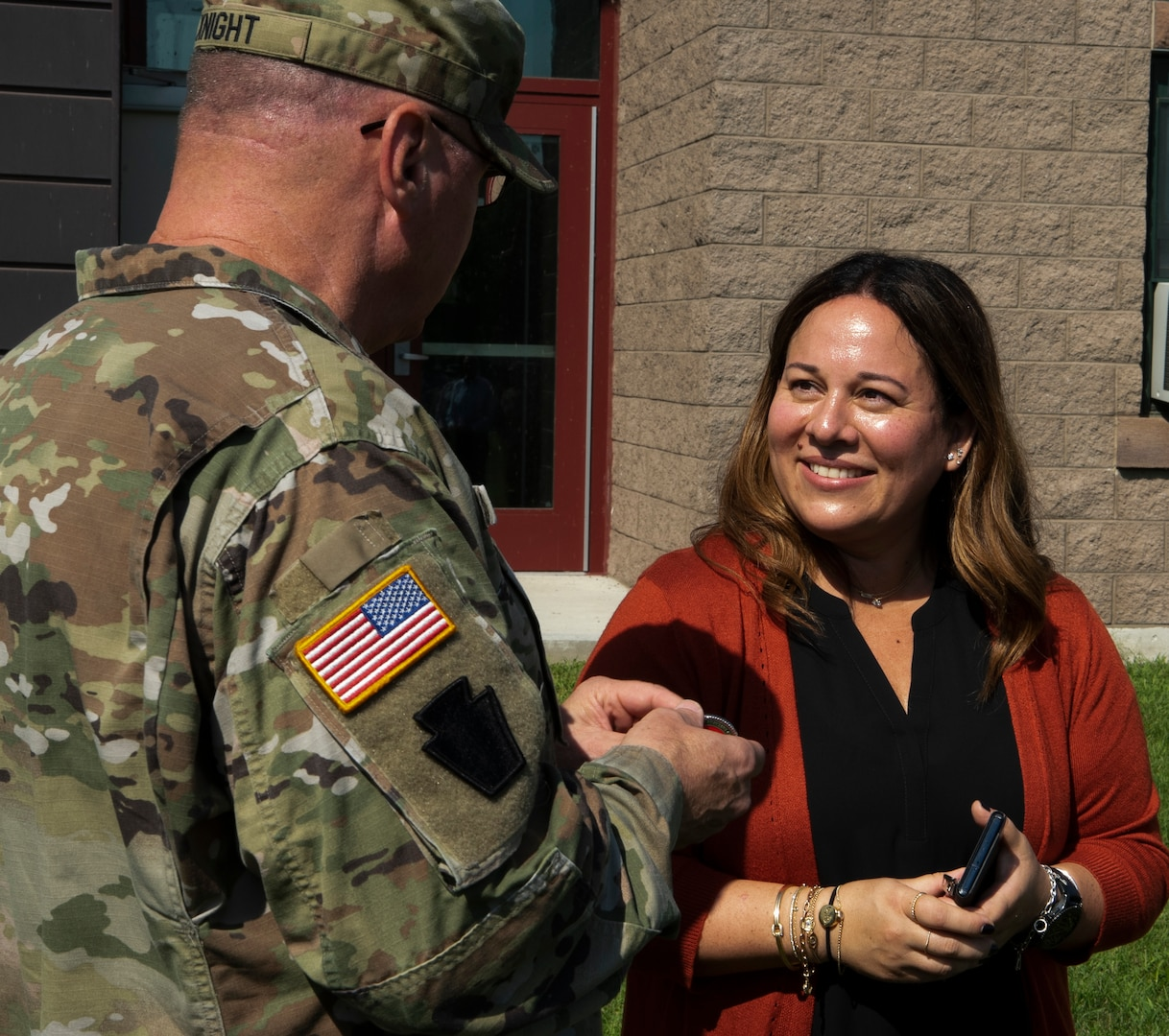 Maj. Gen. Greg Knight, Vermont's adjutant general, presents Dr. Maria Mercedes Avila with a coin during a workshop on structural competence and cultural humility at Vermont Air National Guard Base in South Burlington, Vermont, Aug. 13, 2021. Avila is a member of the Vermont Governor's Workforce Equity and Diversity Council and is working with the Vermont National Guard's Joint Diversity Executive Council to improve inclusiveness within the Guard. (U.S. Army National Guard photo by Don Branum)