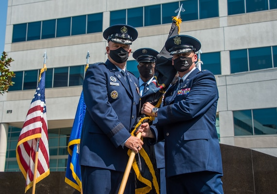 """U.S. Space Force Lt. Gen. Michael A. Guetlein, right, accepts the Space Systems Command flag from U.S. Space Force Chief of Space Operations Gen. John W. """"Jay"""" Raymond, left, during the SSC activation ceremony at Los Angeles Air Force Base, California, Aug. 13, 2021.  (U.S. Space Force photo by Van Ha)"""