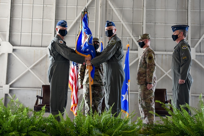 U.S. Air Force Maj. Gen. Chad P. Franks, outgoing commander of Fifteenth Air Force, relinquishes command to Maj. Gen. Michael G. Koscheksi, the incoming commander of Fifteenth Air Force, at the change of command ceremony for Fifteenth Air Force at Shaw Air Force Base, S.C., Aug. 13, 2021. Fifteenth Air Force is responsible for ensuring the agile combat support capabilities of 13 wings and three direct reporting units, preparing Airmen for the dynamic requirements of air, space and cyberspace of the future. These units encompass about 600 aircraft and more than 47,000 active duty and civilian members. Fifteenth Air Force is also responsible for the operational readiness of 16 National Guard and Air Force Reserve Units. (U.S. Air Force photo by Tech. Sgt. Megan Floyd)