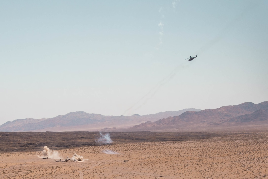 U.S. Marines with Marine Light Attack Helicopter Squadron (HMLA) 773 provide close air support for a live fire aircraft recovery exercise during Integrated Training Exercise (ITX) 4-21 at Marine Corps Air Ground Combat Center, Twentynine Palms, California on Aug. 5, 2021. HMLA-773 is supporting Marine Air Ground Task Force 25 as part of the Aviation Combat Element during ITX, providing close air support and deep air support to the Ground Combat Element. (U.S. Marine Corps photo by Lance Cpl. David Intriago)