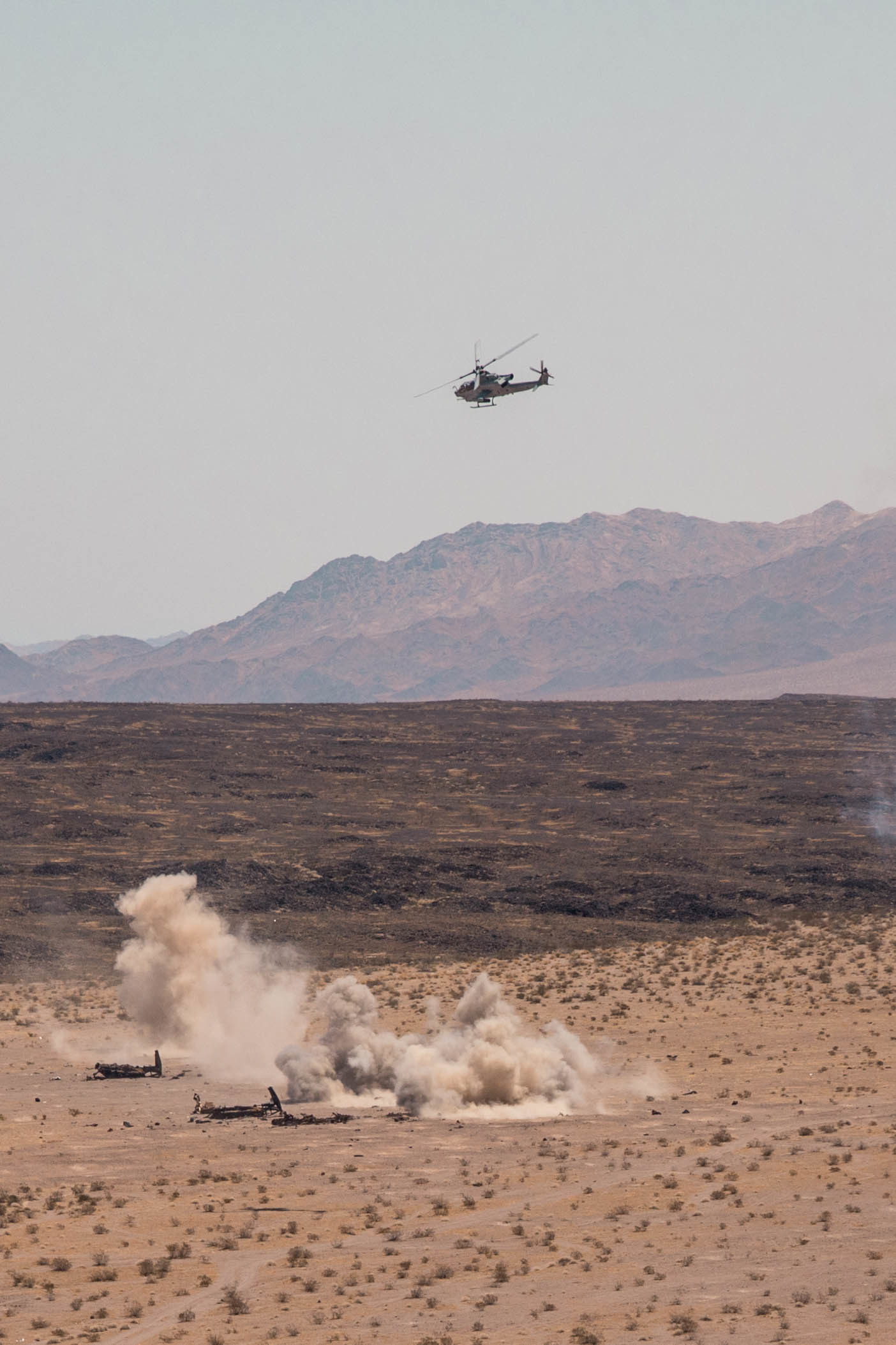 U.S. Marines with Marine Light Attack Helicopter Squadron (HMLA) 773 provide close air support for a live fire aircraft recovery during Integrated Training Exercise (ITX) 4-21 at Marine Corps Air Ground Combat Center, Twentynine Palms, California on Aug. 5, 2021. HMLA-773 is supporting Marine Air Ground Task Force 25 as part of the Aviation Combat Element during ITX, providing close air support and deep air support to the Ground Combat Element. (U.S. Marine Corps photo by Lance Cpl. David Intriago)