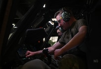 U.S. Air Force Airmen, assigned to the 362nd Training Squadron, Detachment One, check the different mechanisms on a Sikorsky UH-60 Black Hawk helicopter, simulator at Joint Base Langley-Eustis, Virginia, July 16, 2021. The instructors introduce new objectives and techniques throughout the course to help keep the students focused and excited about learning. (U.S. Air Force photo by Senior Airman Sarah Dowe)