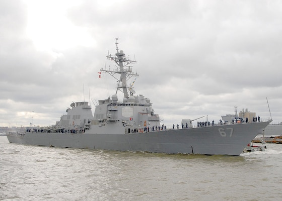 Sailors aboard the guided-missile destroyer USS Cole (DDG 67) heave in mooring lines as the ship departs Naval Station Norfolk. Cole is headed to the U.S. 6th Fleet area of responsibility for a routine deployment focused on ballistic missile defense.